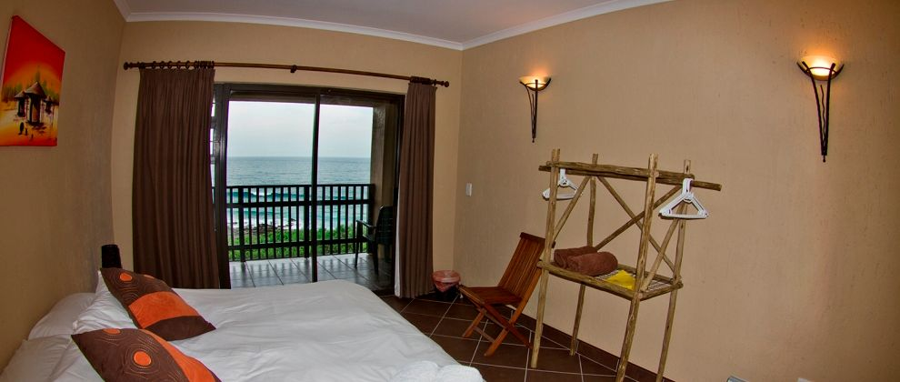 Bedroom with ocean view at ScubaAddicts Lodge