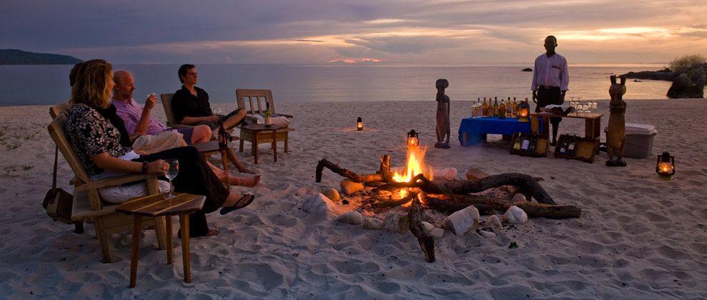 Sundowners around a campfire