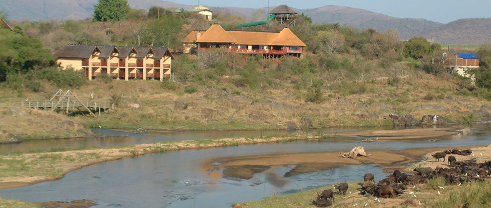 View of Pestana Kruger lodge from across the river