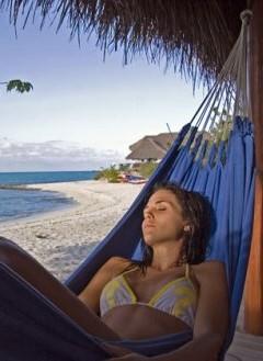 Relaxing in a hammock, Medjumbe Lodge