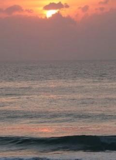 Sunrise over waves at Tofinho